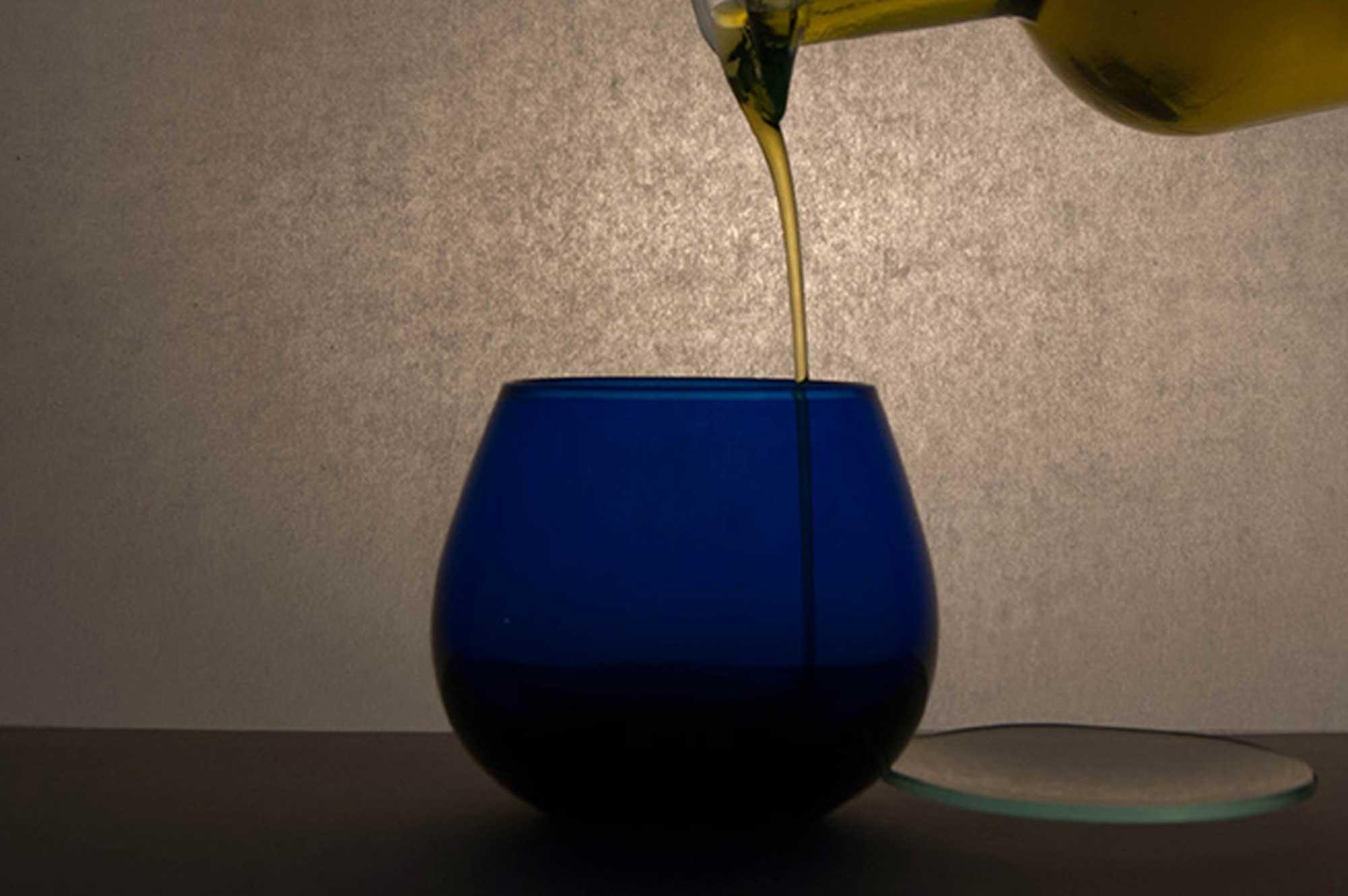 tasting blue glass extravirgin olive oil